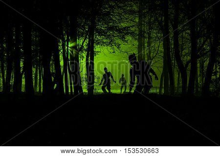 bloodthirsty zombies attacking. hungry zombies in the woods. Silhouettes of scary zombies walking in the forest at night
