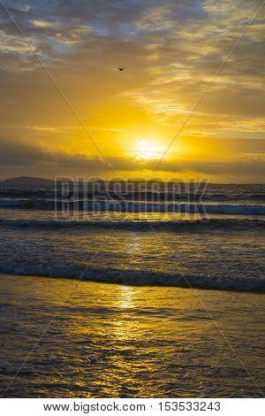beal beach near ballybunion on the wild atlantic way ireland with a beautiful yellow sunset