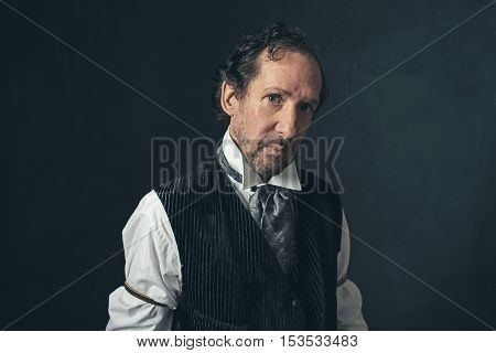Retro Mature Man With Beard In Vintage 1900 Western Clothing.