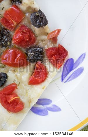 vegetarian pizza with black olives and cherry tomatoes