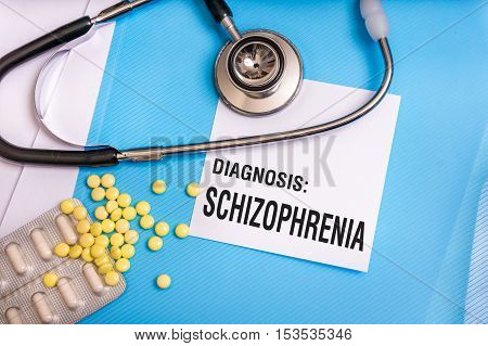 Schizophrenia Word Written On Medical Blue Folder