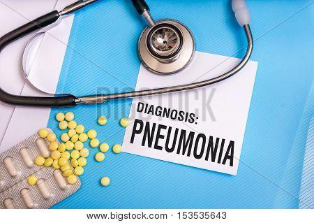 Pneumonia Word Written On Medical Blue Folder