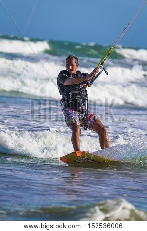 Athletic Man Jump On Kite Surf Board Sea Waves