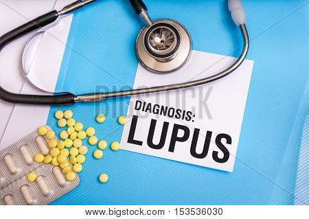 Lupus Word Written On Medical Blue Folder With Patient Files