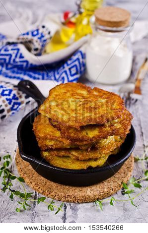 Traditional potato pancakes with sour cream. Selective focus.