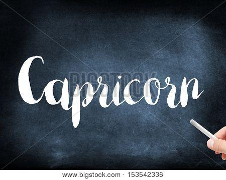 Capricorn written on a blackboard