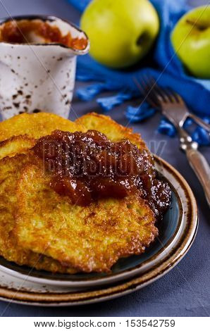 Traditional potato pancakes with apple jam. Selective focus.