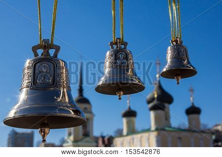 Bronze bells different sizes on a background of the church