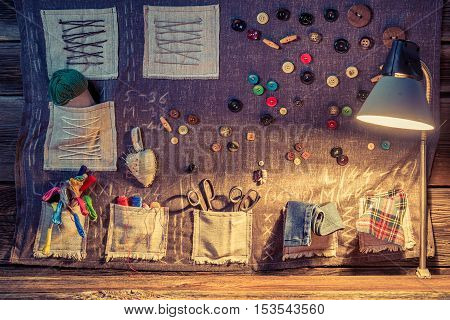 Sewing Cloth With Scissors, Threads And Needles In Tailor Workshop