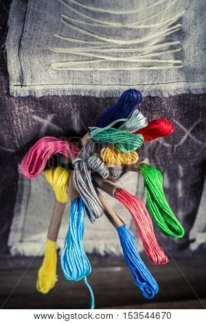 Handmade Sewing Cloth Made Of Threads, Needles And Buttons In Tailor Workshop
