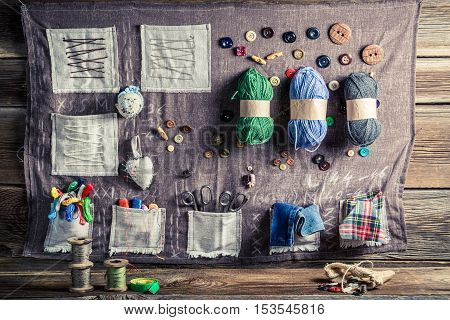 Vintage Sewing Mat Made Of Threads, Needles And Buttons In Tailor Workshop