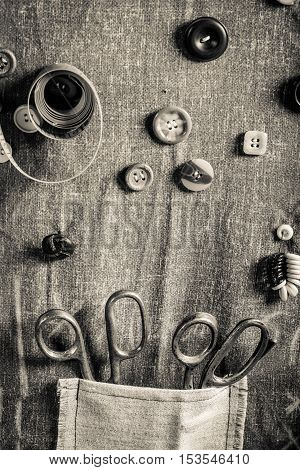 Vintage Background Made Of Buttons, Needles And Threads In Tailor Workshop