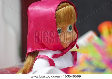 Russian doll with pink kerchief at street market.