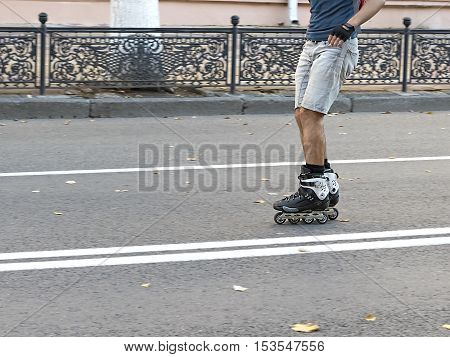 guy rides on roller skates on the road
