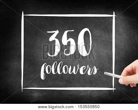 350 followers written on a blackboard