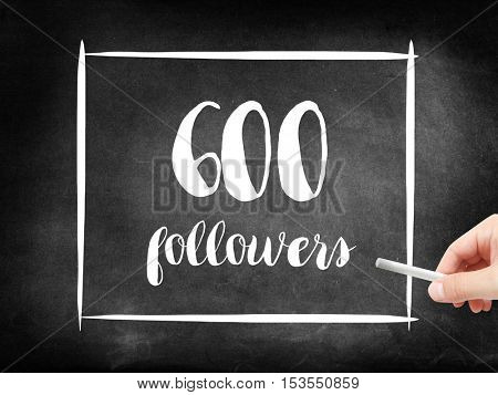 600 followers written on a blackboard