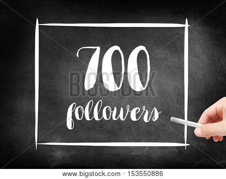 700 followers written on a blackboard