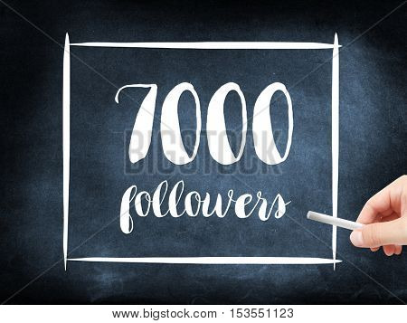 7000 followers written on a blackboard