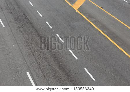 Road yellow and white lines pattern for background