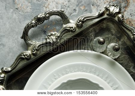 Over head mock up view of silver platter, empty dishes, and salt and pepper