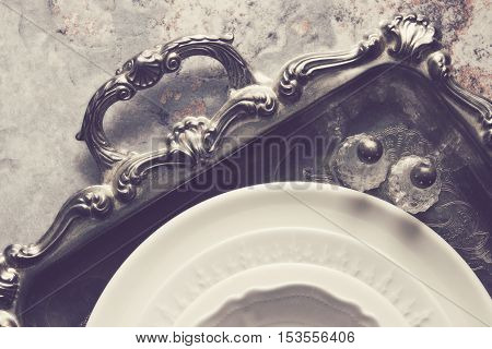 Over head mock up view of silver platter with vintage dishes, salt and pepper