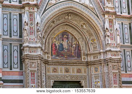 FLORENCE, ITALY - SEPTEMBER 2016 : Jesus holding globe mosaic, Christ Pantocrator, Christian iconography, on west Almond door portal of Florence Cathedral in Florence, Italy on September 21, 2016