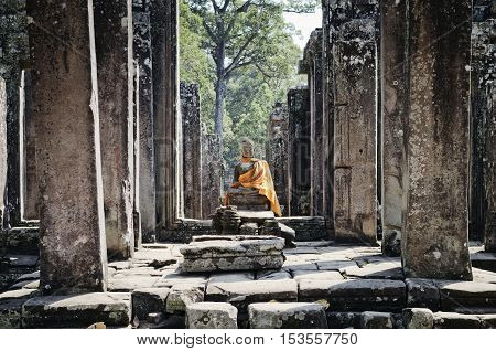 cambodian ancient buddha statue in famous landmark angkor wat temple siem reap cambodia