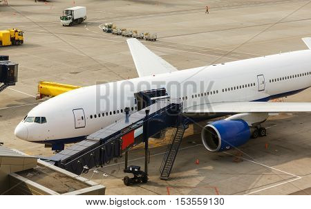 airplane preparing to take off in airport, boarding sleeve is docked for passengers