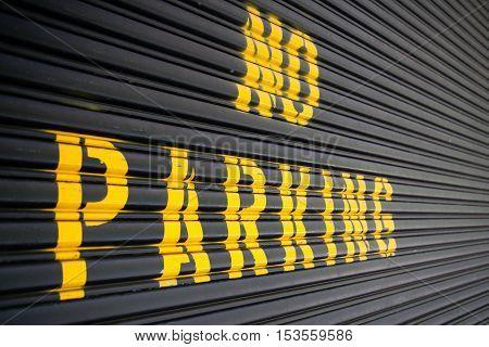 Steel roller garage door with the inscription No Parking