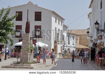 GUADALEST ALICANTE SPAIN - AUGUST 28:Tourists visiting the town hall square in El Castell de Guadalest. Picture taken on August 28 2016 in El castell de guadalest Alicante Spain