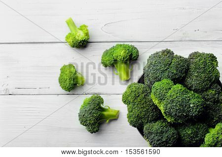 Broccoli Scattered On White Wooden Table.copy Space.top View
