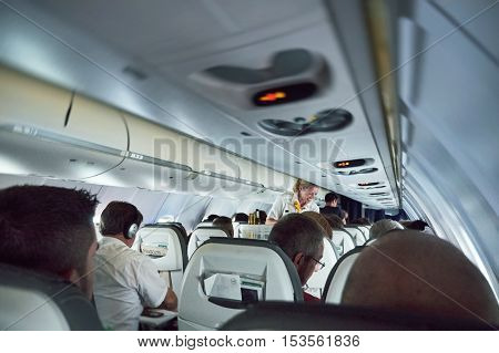 GERMANY - JUN 7 2015: Lufthansa Airlines plane full with passengers with smiling stewardess serving travelers