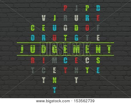 Law concept: Painted green word Judgement in solving Crossword Puzzle