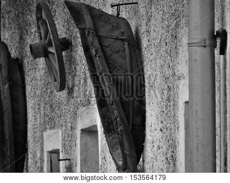 Oxbow hanging on the wall. Leather yoke. Grey yoke.Horse-collar.