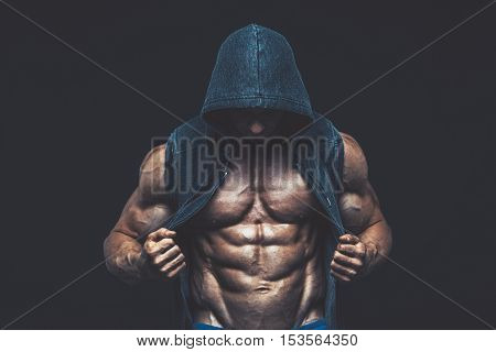 Man with muscular torso. Strong Athletic Man Fitness Model Torso showing six pack abs fighter  kickbox boxer boxing fight poster