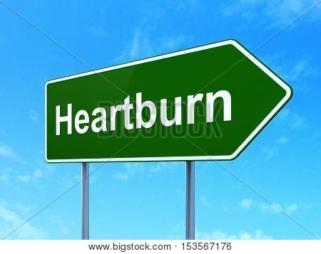 Medicine concept: Heartburn on green road highway sign, clear blue sky background, 3D rendering