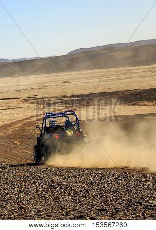 Merzouga, Morocco - Feb 25, 2016: Blue Polaris Rzr 800 In Morocco Desert Near Merzouga. Merzouga Is