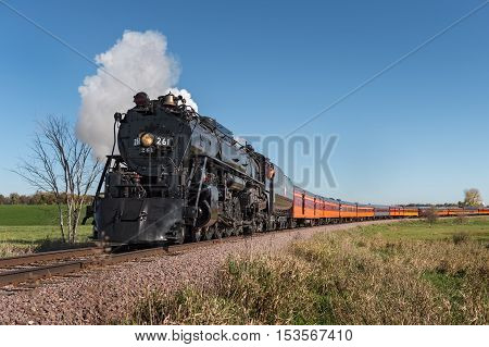 HAMBURG MN - OCTOBER 9 2016: The Milwaukee Road #261 steam train on its Fall Colors Tour from Minneapolis MN to Winthrop MN. This line has not had regular passenger trains traffic since 1960.