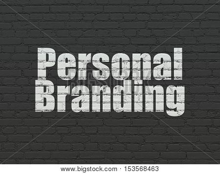 Advertising concept: Painted white text Personal Branding on Black Brick wall background