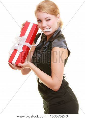 Holidays love and happiness concept - beautiful blonde girl with red gift box winking isolated