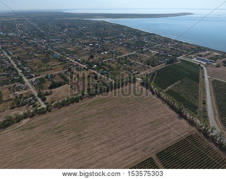 Top View Of The Small Village. Aerophotographing Above The Village. The Village Near The Sea