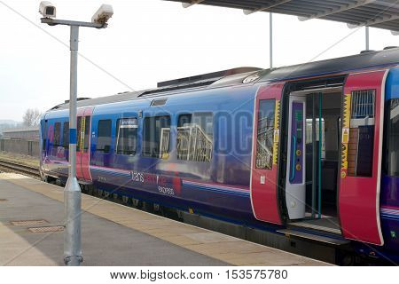BUCKSHAW VILLAGE, UK - MARCH 13, 2016: TransPennine Express train at Buckshaw Parkway railway station, located on Buckshaw village, Lancashire, UK