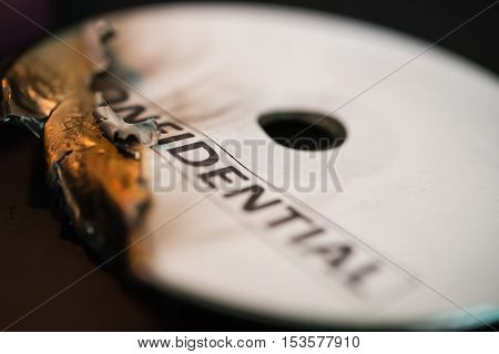 burnt out confidential compact disc on black