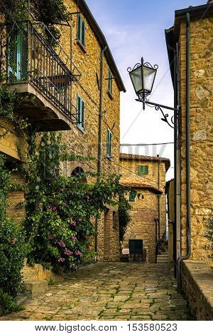 Casale Marittimo old stone village in Maremma on sunset. Picturesque flowery street and traditional houses. Tuscany Italy Europe.
