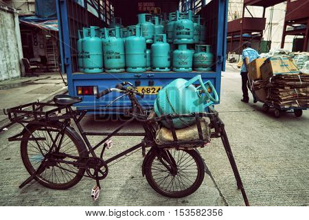Hong Kong - October 2016: Kowloon street view with bicycle and gas bottles.