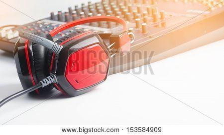 Recording studio equipment control on a white background.