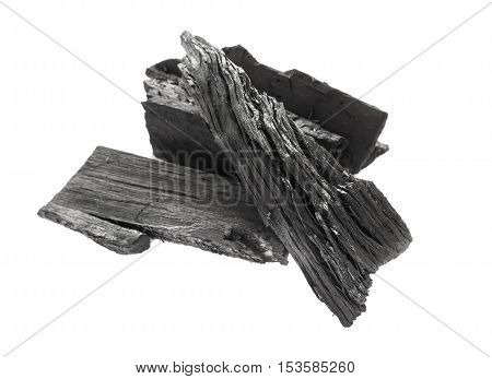 Closeup black charcoal on white background raw material for make cooking