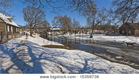 River: snow, ice and small bridge