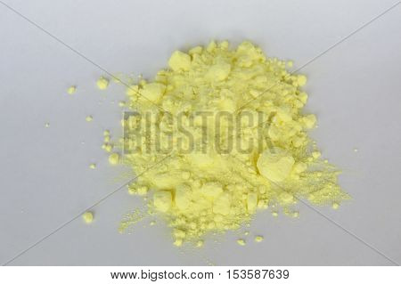 sulphur powder batch on the white paper