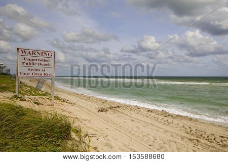 Image of a warning sign on the beach